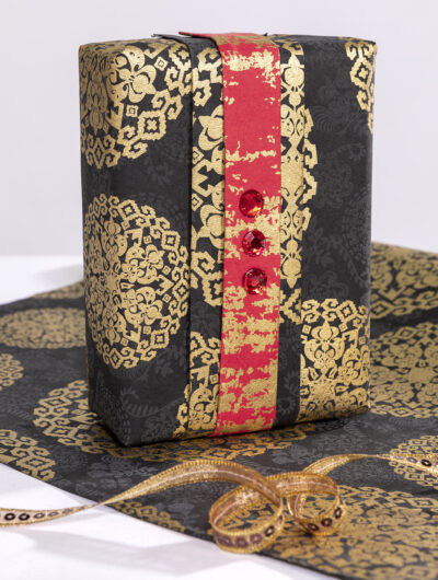Wrapping paper black medallion looks spectacular, and is eco friendly too.