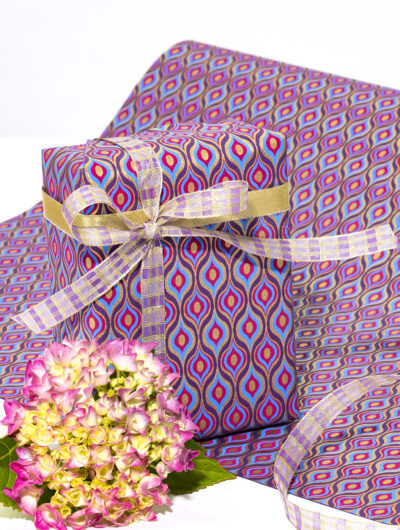 Wrapping paper purple lotus eyes is a handmade and eco friendly gift wrap