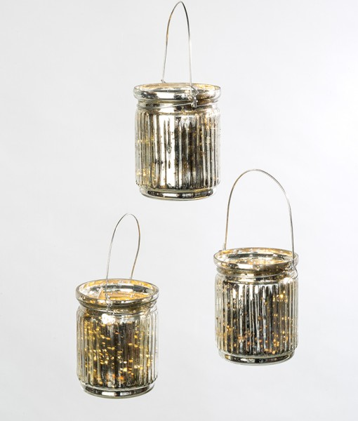 This hanging tea light in silver mercury glass shimmers elegantly when lit.