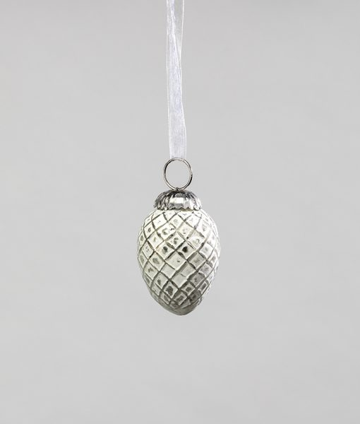 Christmas decorations white/silver acorn with intricate design is elegant.