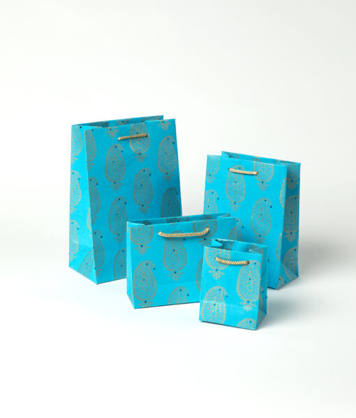 Gift bags turquoise paisley motif is rich vibrant, suitable for celebrations.
