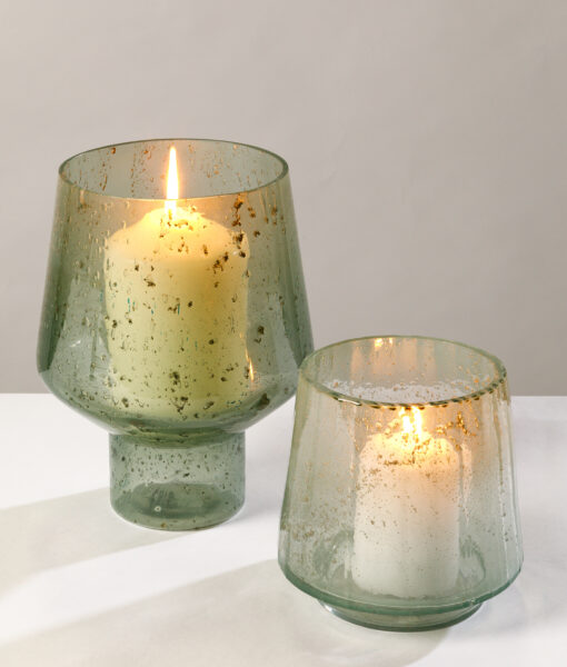 Pebbled candle holder shimmer warmly & create a cosy ambience.