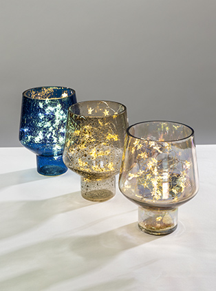 Pebbled finish candle holder shimmer warmly & create a cosy ambience.