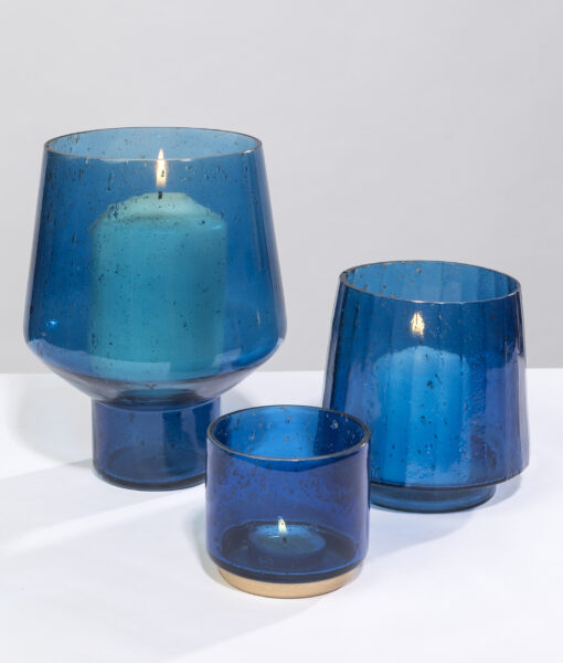 Pebbled candle holder blue shimmer warmly & create a cosy ambience.