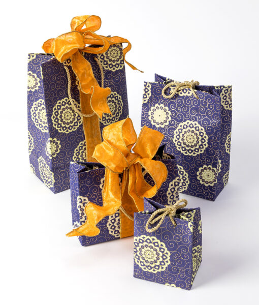 Gift bags navy rangoli is a geometrice design. It is handmade & recycled.