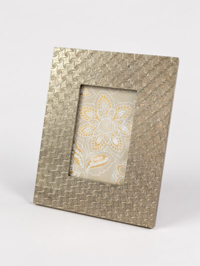 Embossed metal photo frame is smart, elegant, and is an ideal home gift