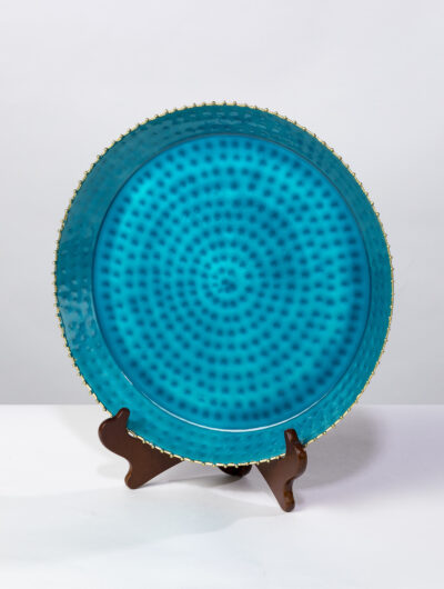 This blue enamel platter with a beaded edge is the essence of fine dinning