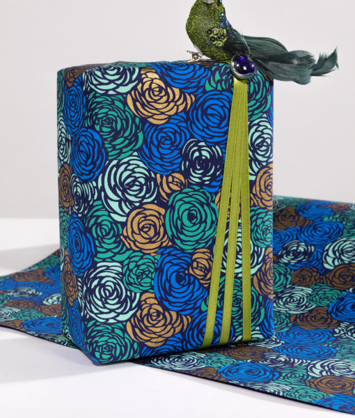 Wrapping paper blue roses is a delightful print available in rich colours.