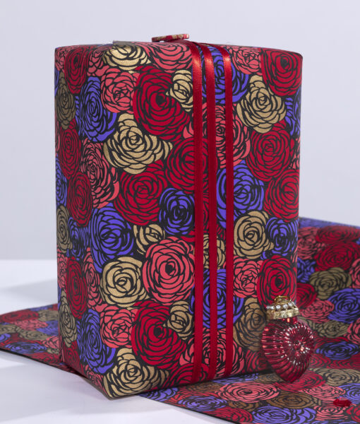 Wrapping paper black roses is a delightful print available in rich colours.