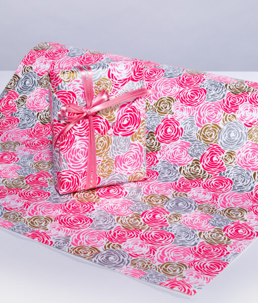 Wrapping paper pink roses is a delightful print available in rich colours.